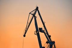 Port cargo crane at sunset Stock Photos