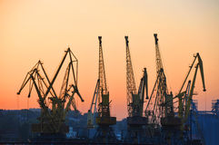 Port cargo crane at sunset Royalty Free Stock Images