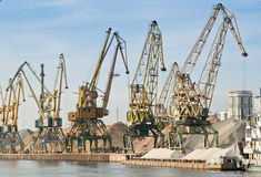 Port with cargo cranes. Port on river with cargo cranes Stock Photos