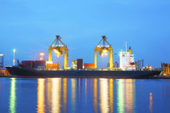 Port cargo freight ship with twilight Royalty Free Stock Photos