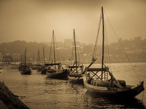 Port carrying ships lined up on the Duoro. A row of transport ships lined up in Porto, ready to carry the port wine off to markets Royalty Free Stock Image