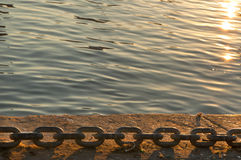 The Port Chain at the Sunset. The sunset at the quay in Livorno port Royalty Free Stock Photos