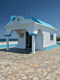 Port chapel ST. Apostoli Faliraki, Rhodes. The quaint and charming church of St Apostolos, tucked away in the harbour, is a perfect venue for a relaxed seaside Royalty Free Stock Images