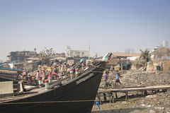 The port of Chittagong, Bangladesh. CHITTAGONG, BANGLADESH - FEBRUARY 2017: The port with many people and boats in the center of Chittagong in Bangladesh royalty free stock images