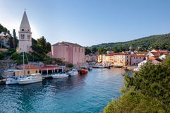 Port and church landscape at Veli losinj Stock Photography