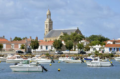 Port and church of Saint Gilles Croix de Vie in Fr. Port of Saint Gilles Croix de Vie in with the church Sainte Croix in the background, commune in the Vendée Stock Photos
