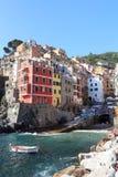 Port of Cinque Terre village Riomaggiore with colorful houses Stock Photo