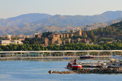 Port and city with ancient fortress. Malaga, Spain Royalty Free Stock Photography