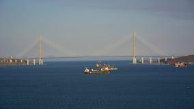 Port city high bridge across the Bay, the coastline, waves and blue sky. Beautiful maritime city Royalty Free Stock Image
