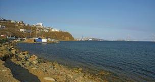 Port city high bridge across the Bay, the coastline, waves and blue sky. Beautiful maritime city Stock Photo