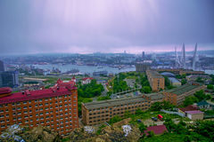 Port city view from the heights, high Bay braced bridge, thick fog. Marine City. Vladivostok stock photography