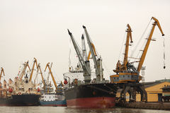 Port or commercial harbor with cargo ship and cran Stock Photo