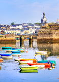 Port of Concarneau, Brittany, France. Colorful fishermen boats in little resort town in Brittany, France royalty free stock photography
