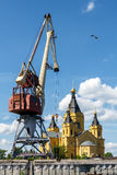 Port crane and Alexander Nevsky Cathedral on the Strelka in Nizhny Novgorod. Alexander Nevsky Cathedral in the district of cargo river port of Nizhny Novgorod on Royalty Free Stock Image