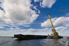 Port crane and barge Stock Photo