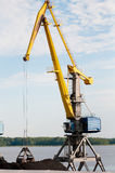 Port crane loading coal Royalty Free Stock Photos