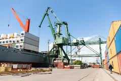 Port crane loading container ship with cargo Royalty Free Stock Image
