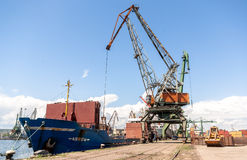 Port crane loading container ship with cargo Stock Photo