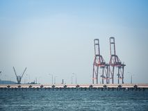 Port crane loads a container on Pier Royalty Free Stock Images