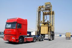 Port crane lowering container Royalty Free Stock Photos