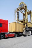 Port-crane lowering container Royalty Free Stock Photo