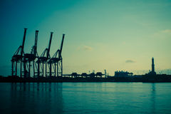 Port with crane silhouettes Royalty Free Stock Images