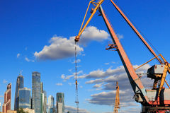 Port crane and skyscrapers in Moscow City Royalty Free Stock Image