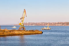 Port crane on the Volga River. Kineshma. Russia Royalty Free Stock Photography