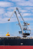 Port crane at work Stock Image