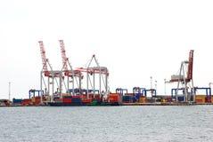 Port cranes. Huge cargo port cranes in their operation Stock Photo