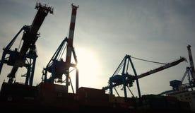 Port Cranes. Cranes loading ship, container, Genoa port, Italy Stock Photos