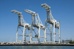 Port Cranes. June 12, 2011. Oakland, California, USA. Port of Oakland cranes used to load shipping containers onto cargo ships. Useful for articles about freight royalty free stock photography
