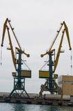 Port cranes. Two port cranes in sea port Stock Photo