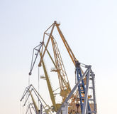Port cranes. Against the sky Stock Image