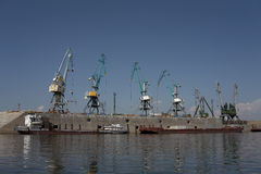 Port cranes on the bank. Royalty Free Stock Photo