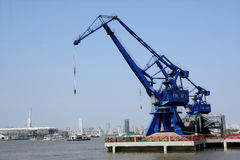 Port cranes with blue sky in background in shanghai,China Stock Photos
