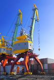 Port cranes with blue sky Royalty Free Stock Images