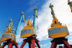 Port cranes with blue sky Royalty Free Stock Photos