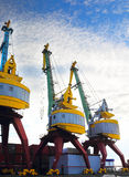 Port cranes with blue sky Stock Photo