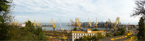 Port cranes in cargo front of Odessa sea commercial port - logistic center stock photo