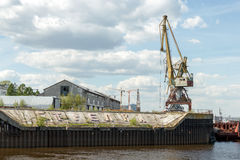 Port cranes in cargo river port on the Strelka in Nizhny Novgorod. Strelka, Nizhny Novgorod. Port cranes and buildings of the cargo river port. View from the Royalty Free Stock Image