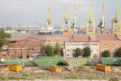 Port cranes with cargo trainand warehouse Royalty Free Stock Photography