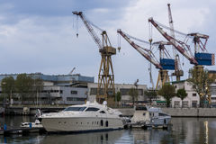 Port with cranes. Port channel with cranes and boats stock photos
