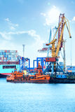 Port with cranes, containers and cargo Stock Images
