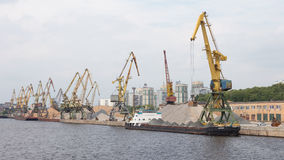 Port cranes loaded gravel barge Royalty Free Stock Photo