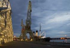 Port cranes at Maritime center Vellamo summer night. Kotka Royalty Free Stock Photography