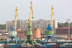 Port cranes with old  warehose. Stock Photo