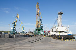 Port cranes in sea port Stock Photos