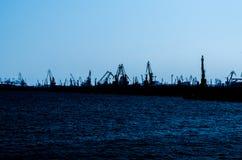 Port Cranes Silhouettes Stock Image
