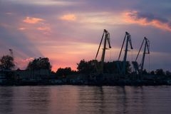 Crane silhouettes at the sunset royalty free stock images